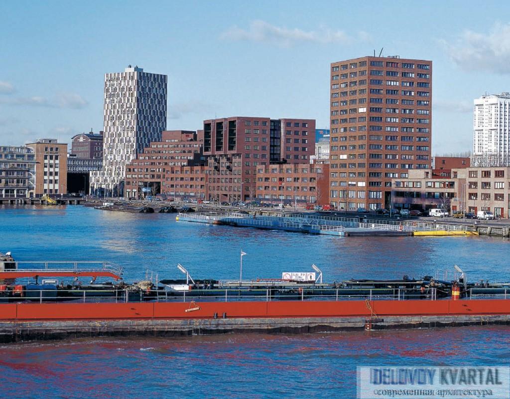 Подчеркнуто квадратные формы зданий и темный кирпич, которым облицованы фасад , призваны подчеркнуть соседство этого объекта с объектами портовой архитектуры. Neutelings Riedijk Architects